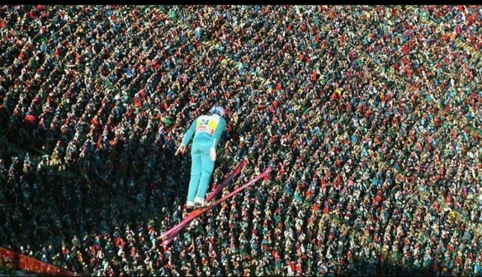 """Eddie """"The Eagle"""" Edwards Soars Above A Roaring Crowd At The 1988 Winter Olympics. He Finished Last"""
