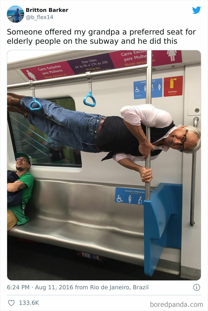 Old Man Sideways Holding Onto A Vertical Pole