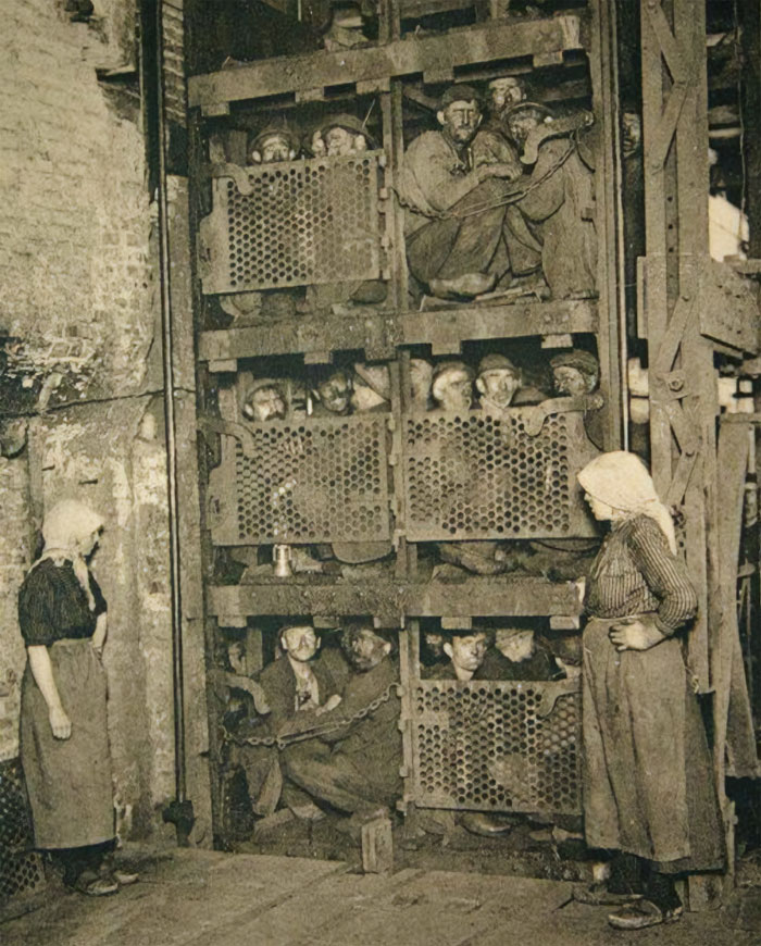 Coal Miners Coming Up A Coal Mine Elevator After A Day Of Work In 1920's Belgium