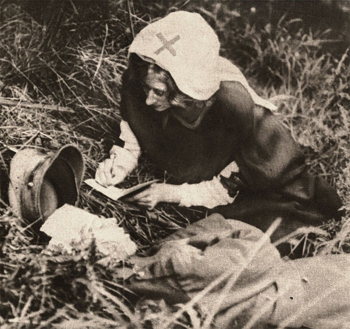 A Red Cross Nurse Writing Down Last Words Of Mortally Wounded Soldier, Taken Around 1917