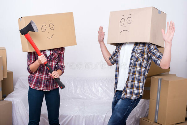 moving-home-cheerful-young-couple-cardboard-boxes-their-heads-women-holds-ax-47465901.jpg