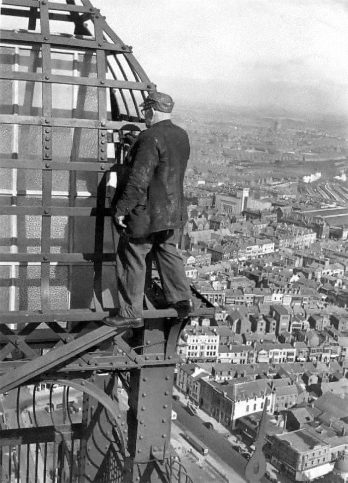 No Health And Safety Back In The Day. Guy Painting Blackpool Tower In The UK