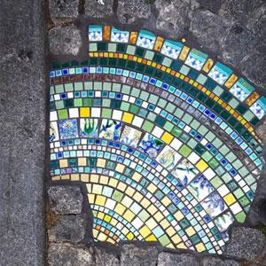 Artist Fills Cracked Sidewalks, Potholes, And Buildings With Vibrant Ceramic Mosaics (70 Pics)
