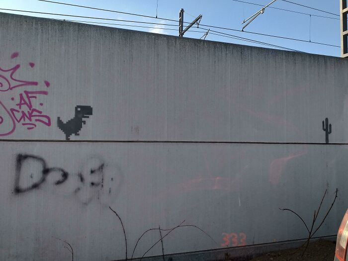 T-Rex Runner Near Some Train Tracks