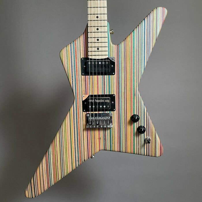 Made A Guitar Out Of 45 Old Skateboard Decks. Turned Out Pretty Cool I Think