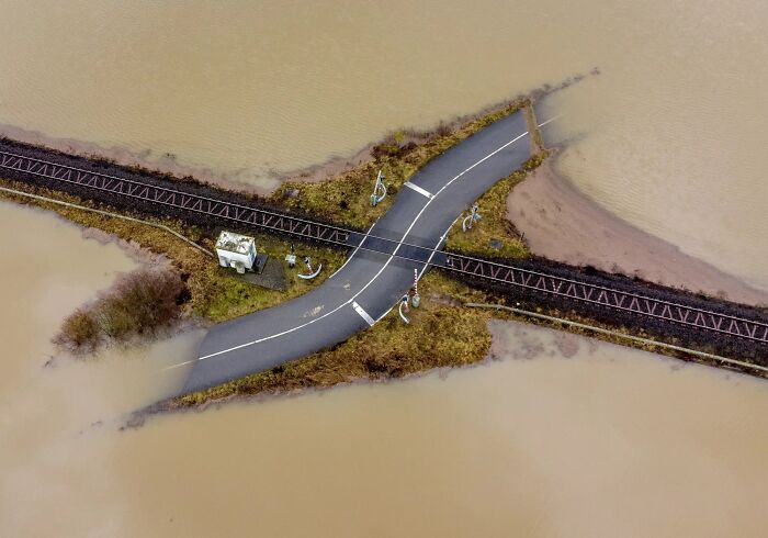 A Railroad Crossing Is Surrounded By Flooding Near Frankfurt, Germany (Michael Probst)