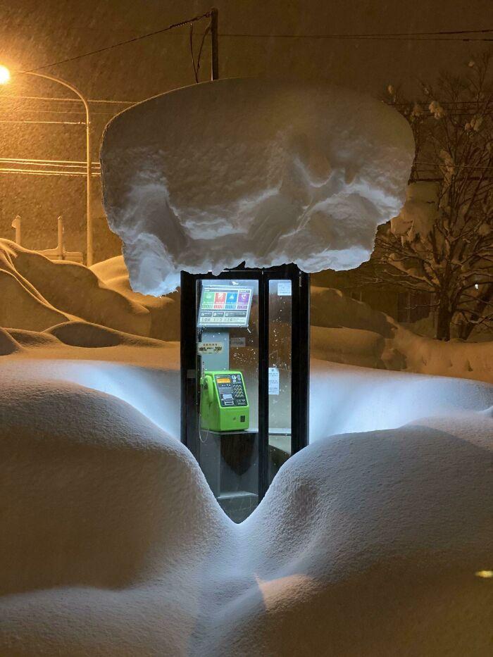A Phone Box In Snow