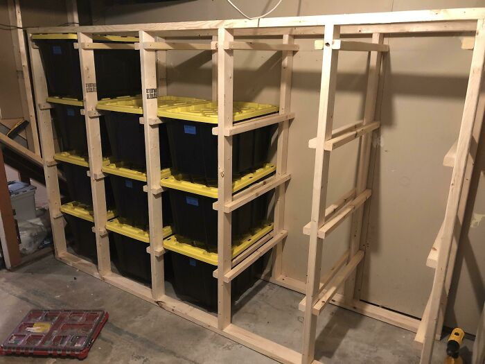 I Standardized All My Storage Bins But Got Tired Of Unstacking/Restacking Every Time I Needed Something From The Bottom Bin. I Built This Rack So Each Bin Can Slide Out, And It Wastes Very Little Storage Space. What Do You Think?