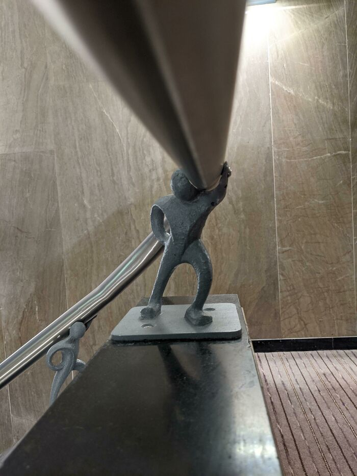 The Banisters At My Hotel Were Held Up By Little Metal Men