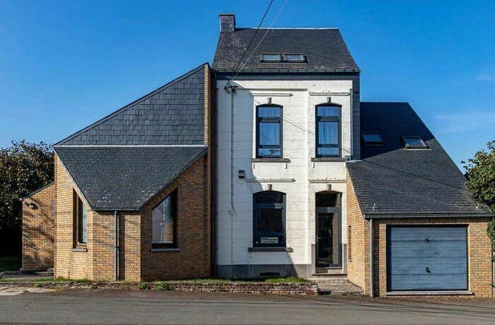La fea casa belga está envolviendo lentamente a su presa