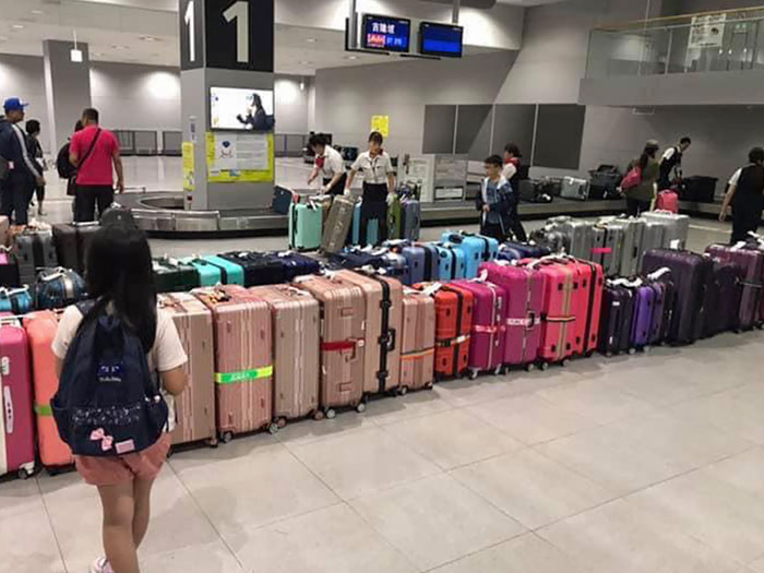 At Japanese Airports, The Baggage Handlers Arrange Luggage By Color So It's Easier For You To Find Your Bag