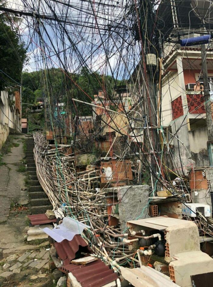Electrical Wiring And Water Pipes In A Brazilian Favela