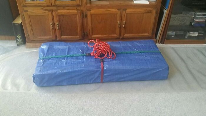 The Tool Set Gift I Got My Dad For Father's Day Was Heavy And Awkward To Wrap Traditionally, So I Bought A Small Tarp And A Pack Of Colorful Bungee Cords To Act As Gift Wrap And Ribbon! Practical And Only Cost Me $10!