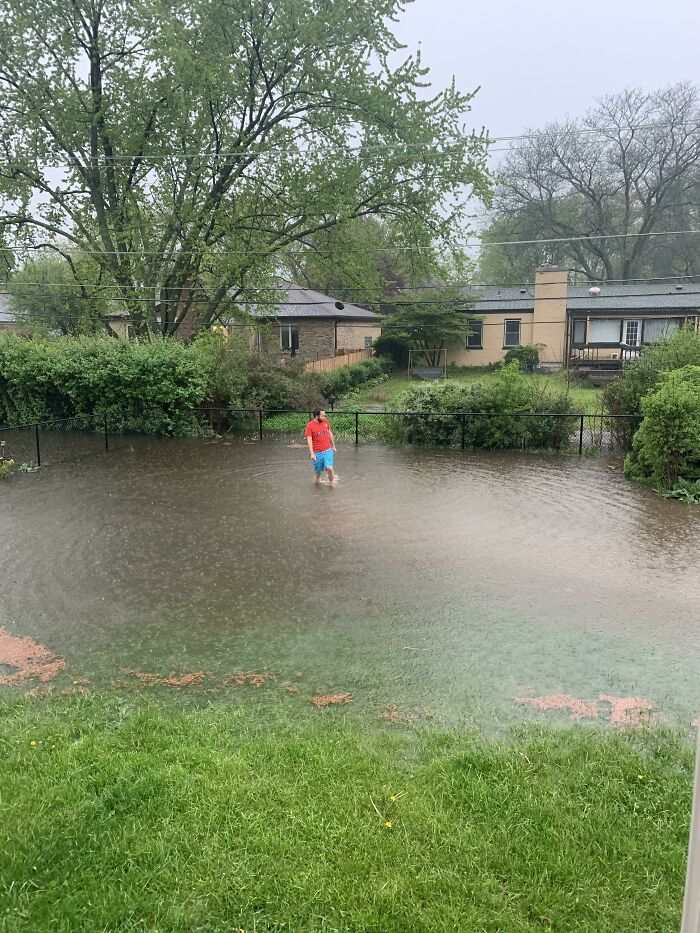 Got A Little Bit Of Rain In The Backyard. Husband For Scale. Note: We Don't Usually Have A Lake In The Yard