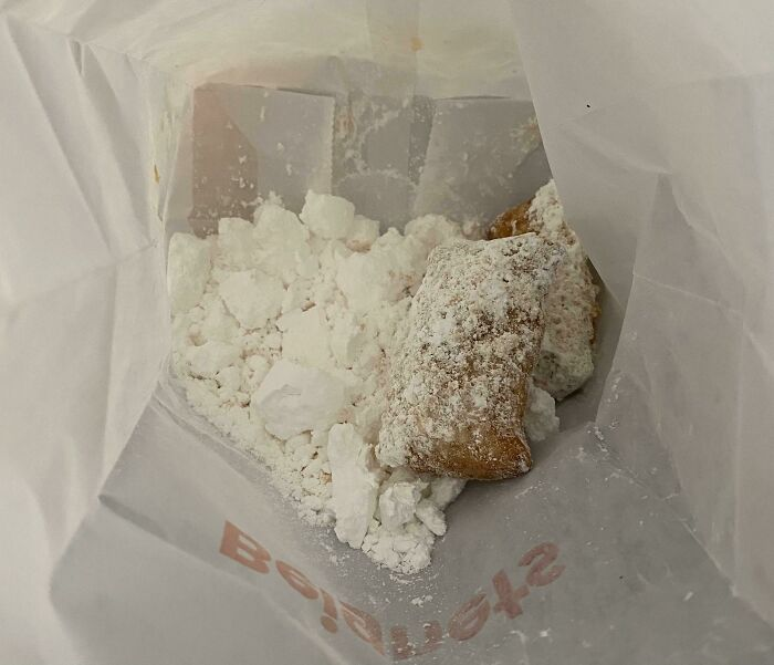 I Got A Couple Of Beignets In This Bag Of Powdered Sugar From Popeye's