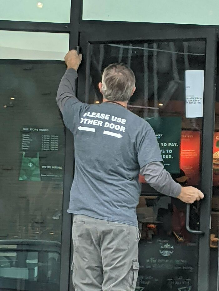 Maintenance Guy's Shirt Doubles As A Helpful Sign