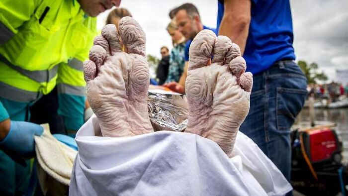 Feet From Dutch Olympic Swimming Champion Maarten Van Der Weijden After Swimming 163 Km/101 Mi In 55 Hours To Raise Money For Cancer Research
