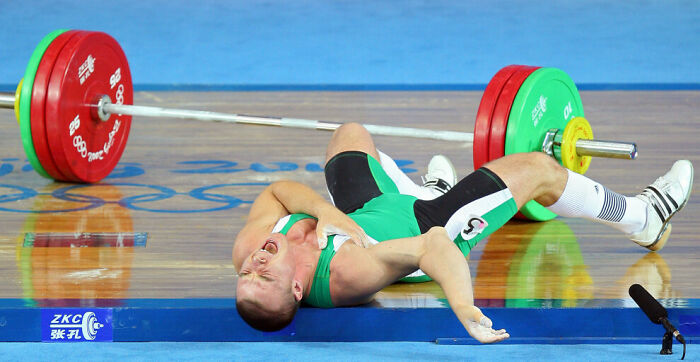 Hungarian Weightlifter Janos Baranyai's Right Arm Gave, Ripping Apart Ligaments And Muscle Under The Weight