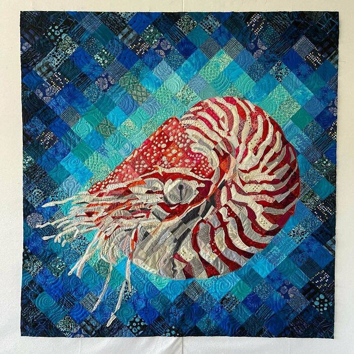 """I Made This Nautilus Art Quilt Using Raw Edge Appliqué Combined With Traditional Piecing. I Free-Motion Quilted It With A Variety Of Thread Weights To Add More Texture. I Encouraged Fraying Of The Fabrics To Give More Interest To The Piece. 58""""x61"""""""