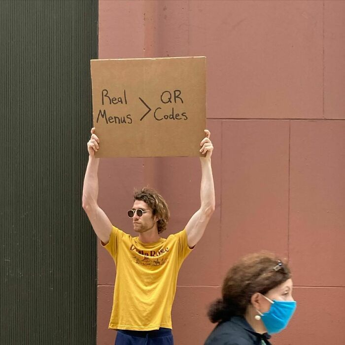 Dude-Holding-Signs-Protesting