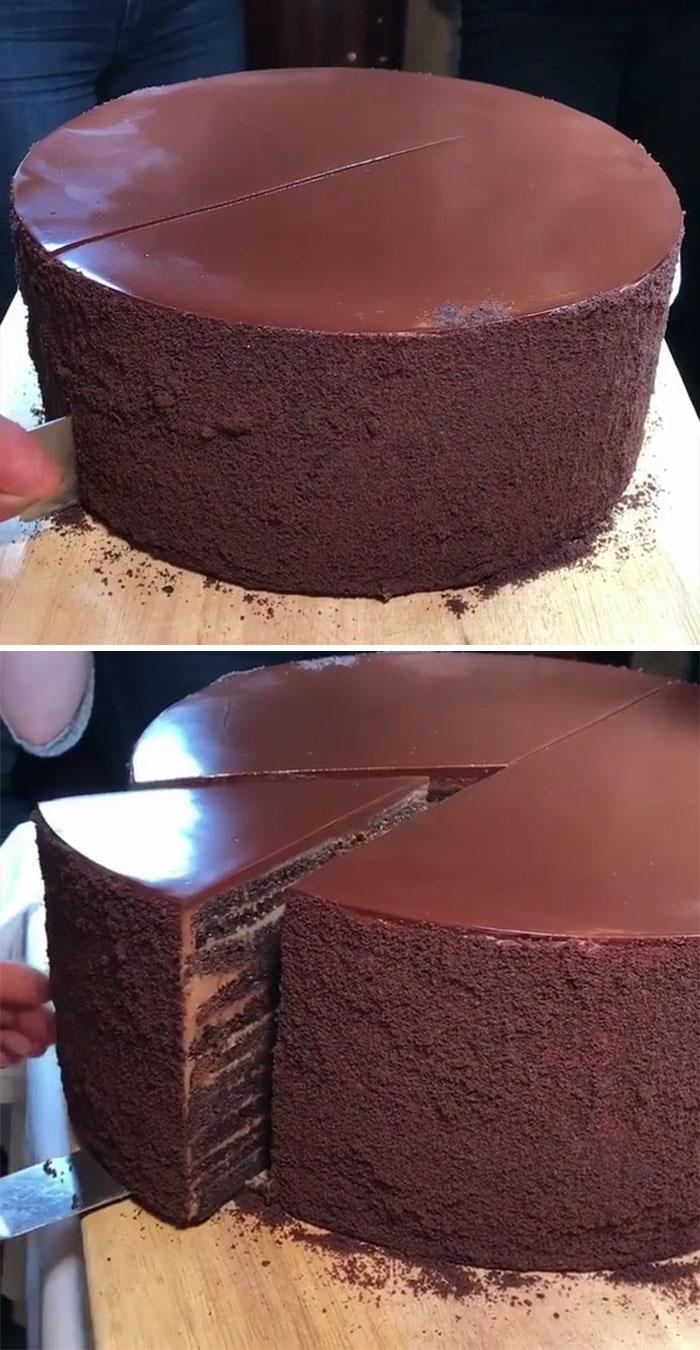 Cutting A Slice Of 23 Layer Chocolate Cake