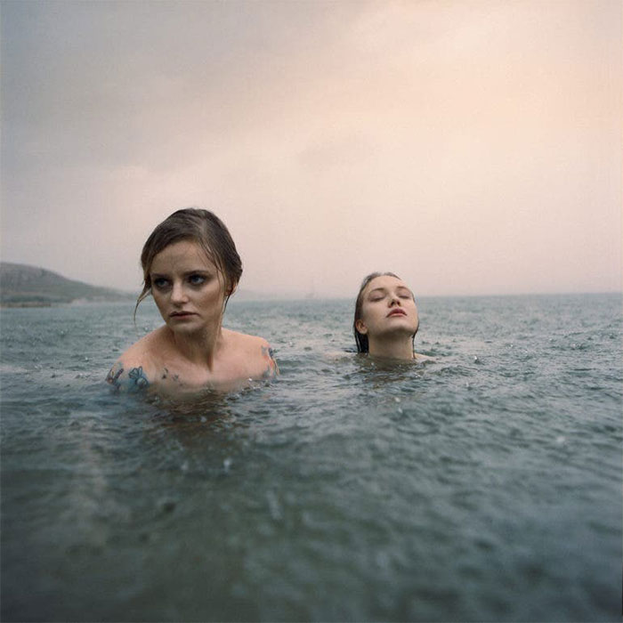 Photographer Uses An Analog Camera To Capture Eerie And Surreal Photos Of People (30 Pics)