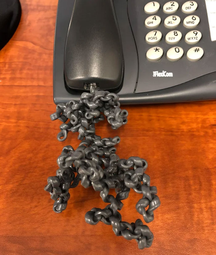 Had To Use My Coworkers Office Today Who Is On Vacation To Make Some Phone Calls. This Is What His Phone Cord Looks Like