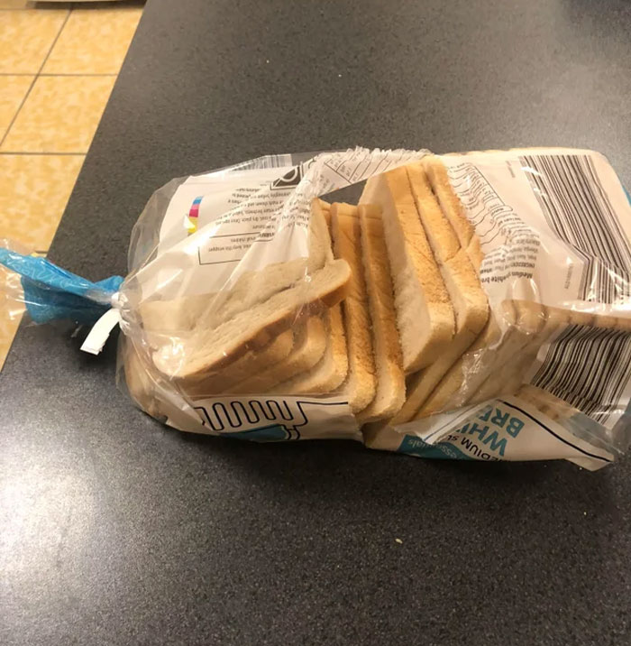 The Caveman Like Way My Co Worker Has Opened His Bread