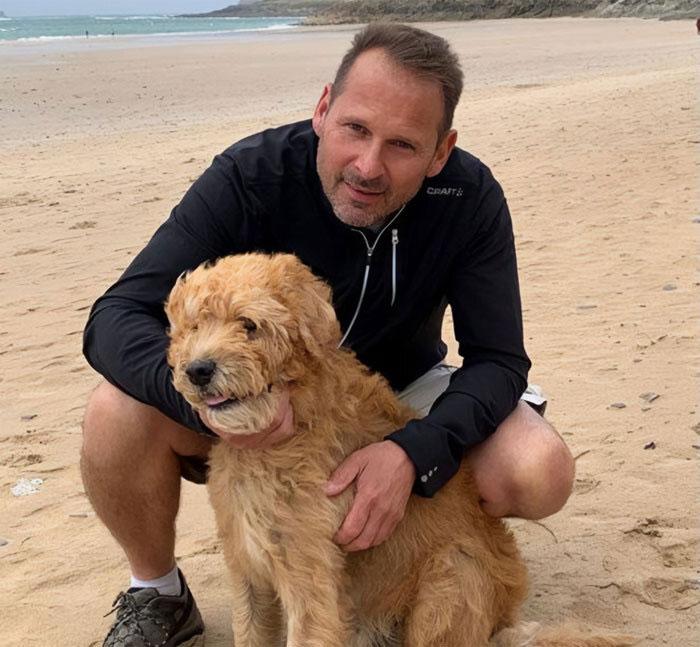 Heart-Gripping Photos Show A Man Taking His Sick Dog For 'One Final Adventure' In A Wheelbarrow