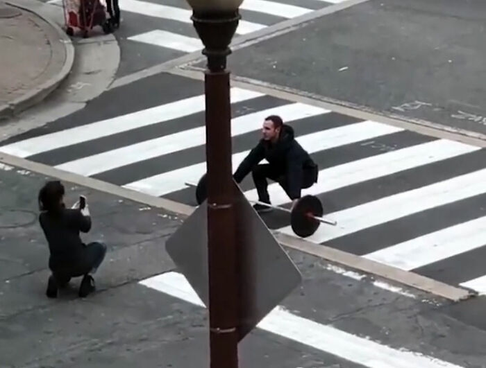 Influencer Doing Deadlifts In The Middle Of The Street