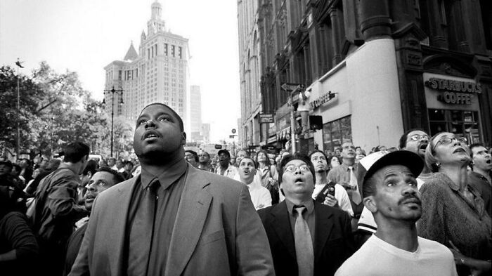 Onlookers In Horror And Disbelief As They Watch The Twin Towers Collapse On 9/11