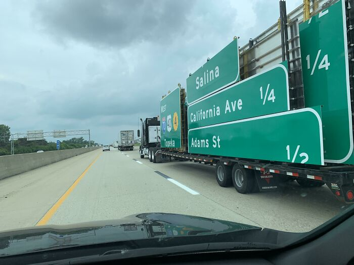This Is A Truck Carrying The Signs You See On The Interstate