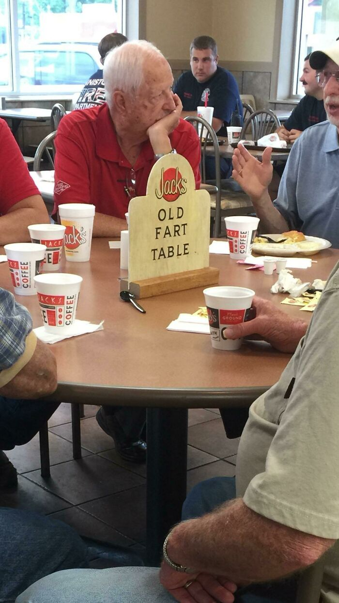 These Guys Sit At This Table Every Morning. The Restaurant Owners Made This Sign To Claim The Table For Them