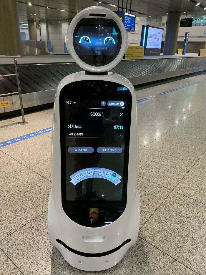These Helpful Robots That Wander Incheon Airport, Seoul, That You Can Use To Check Flight Information