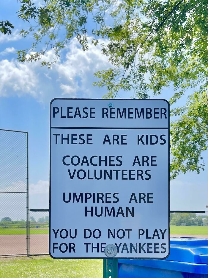 Sign Posted At A Community Ball Field