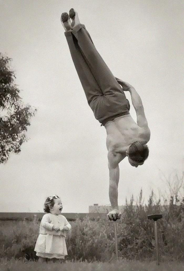 Dad Showing Off His Skill To The Surprise Of His Little Daughter In Melbourne, Australia, Ca. 1940s