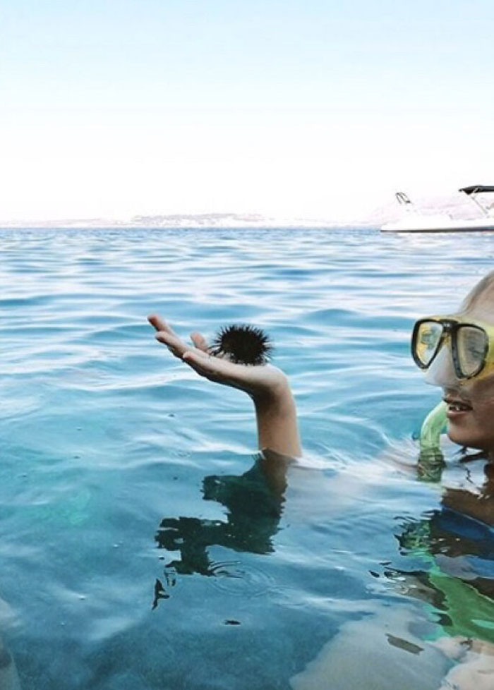 Man With Curly Hair About To Dive Into The Water