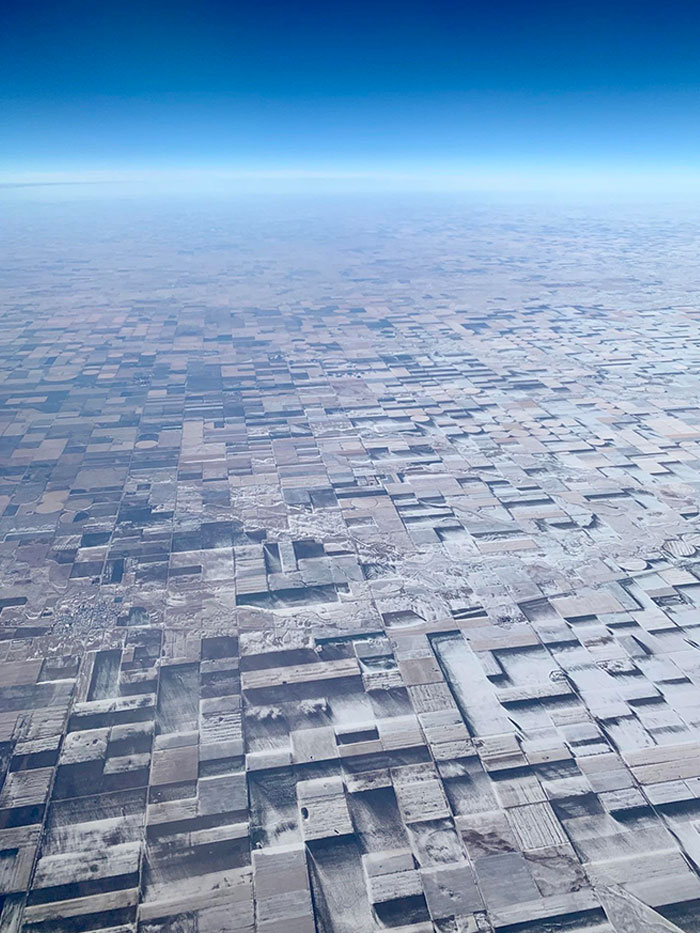 This Is Flat Farmland In Eastern Colorado With Windblown/Melted Patches Of Snow Creating A Crazy 3D Illusion