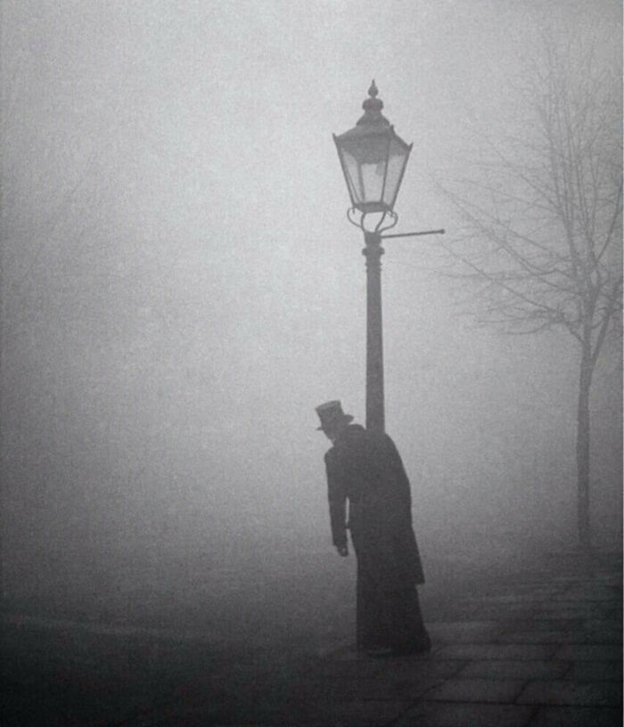 A Drunken Man In Top Hat And Tails Clings To A Lamp-Post, London, 1934. Photo By Bill Brandt