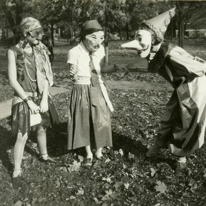 Three Girls In Masked Costumes At Halloween Festivities In College Hill, Cincinnati, Ohio In 1929
