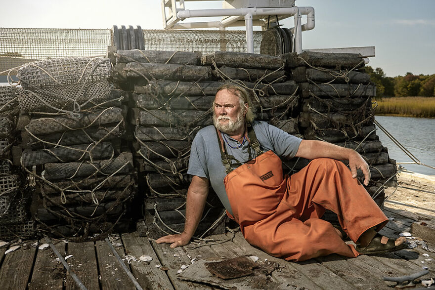 Oyster Man On Dock After A Day Of Farming By Nicola Ducati