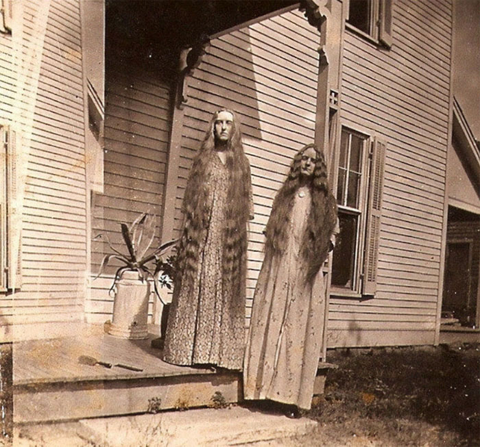 Photo Of Two Women With Super Long Hair