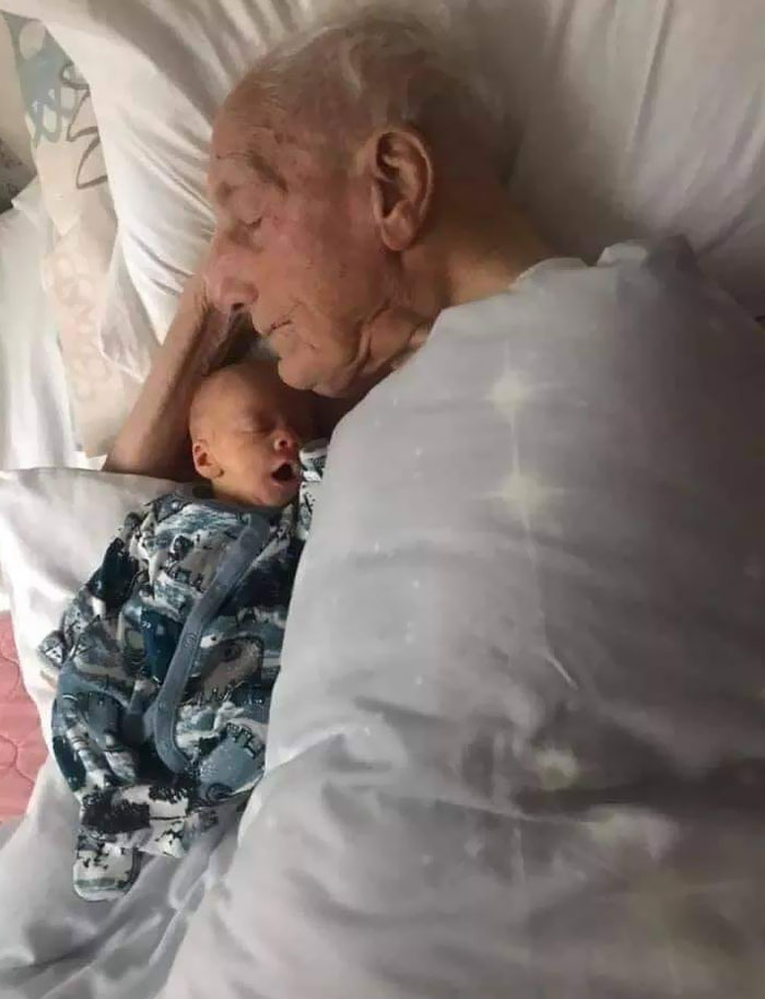 A 5-Week-Old Sleeping Next To His 101-Year-Old Great-Grandfather