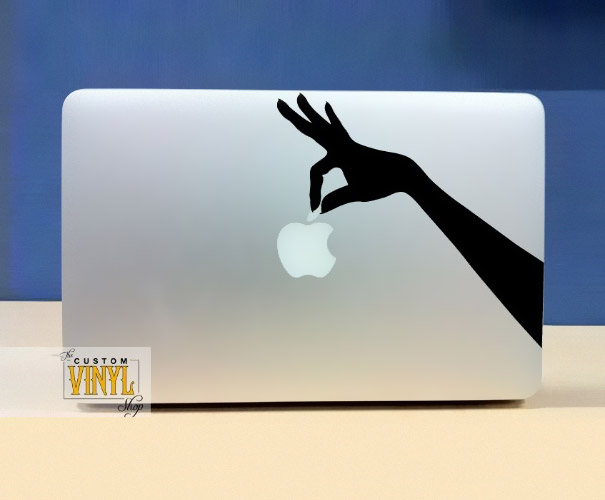 A cool macbook sticker that will make it look as though a hand is holding the apple buy