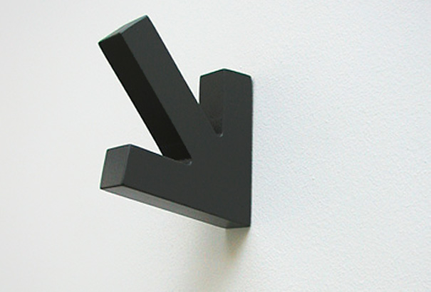 It's an arrow, basically just pointing to the general area of itself. It's  a coat hook. It knows exactly where you'd be precisely in the area of cool  ...