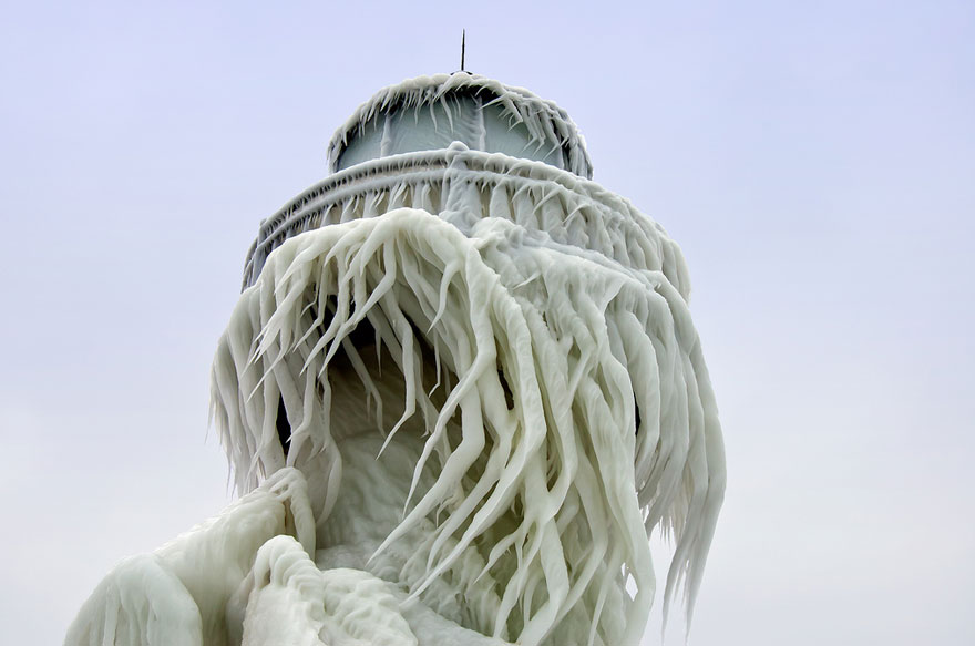 Frozen Lighthouses Caught In Winter S Icy Grip On Lake