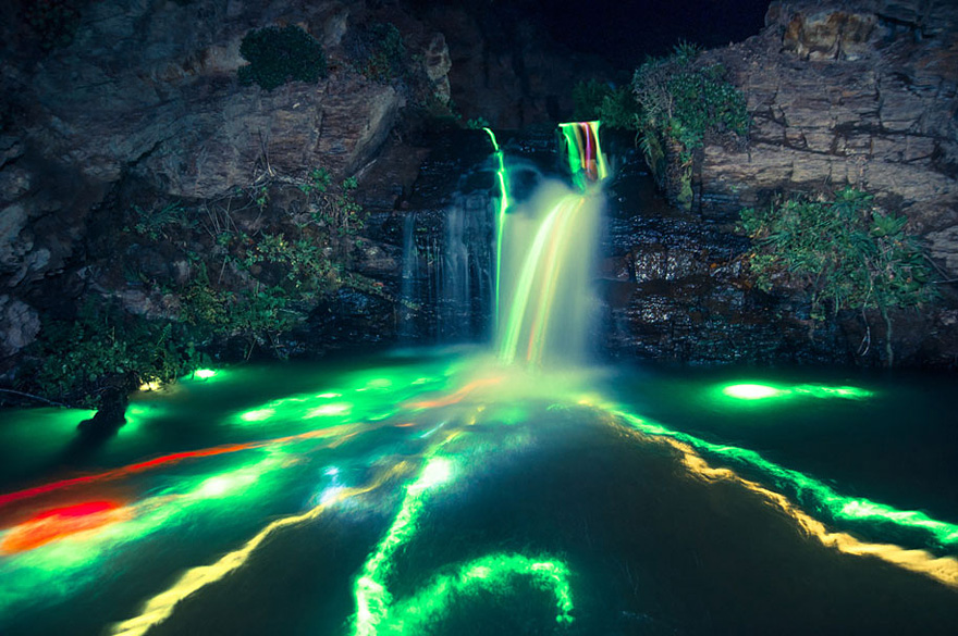 What Happens When You Throw Some Glow Sticks into a Waterfall