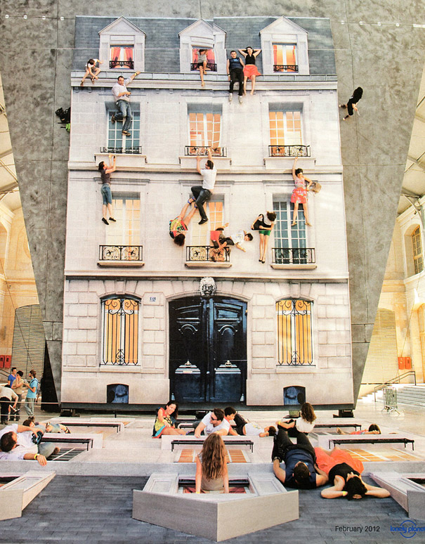 Giant Mirrored Building Facade Turns Visitors Into Spiderman