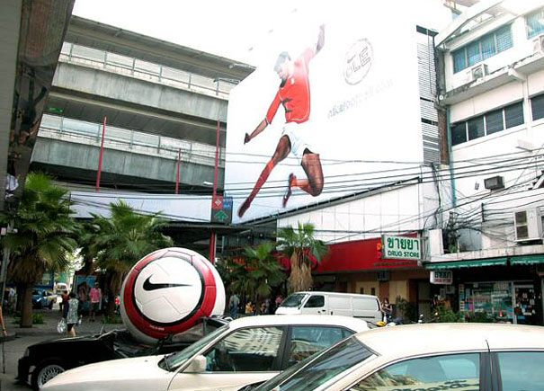 http://static.boredpanda.com/blog/wp-content/uuuploads/oversized-objects-in-advertising/large-scale-objects-nike-football-2.jpg