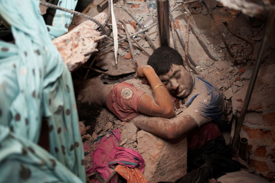15 Embracing Couple In The Rubble Of A Collapsed Factory